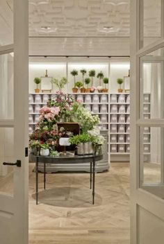 Inspiring Design: Club Monaco Flagship Store, blonde hardwood floor, french doors, grey, green, pink