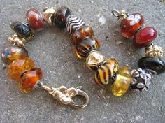A beautiful bracelet from a Danish collector!  From Trollbeads Gallery Forum, ca 2009! The bead are all so special, especially the gold Trollbeads.