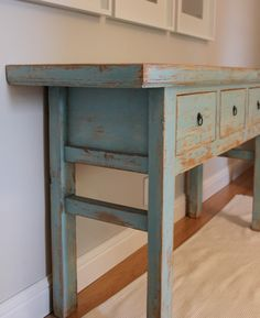 distressed reclaimed table. love.   at the entrance or something. Or if we do the open coat closet thing do the wood like this <3