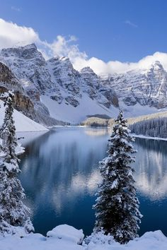 Moraine Lake is a glacially fed lake in Banff National Park, miles outside the village of Lake Louise, Alberta, Canada. It sits in the Valley of the Ten Peaks at an elevation of feet. Winter Szenen, Winter Magic, Landscape Photography, Nature Photography, Snow Scenes, Winter Pictures, Winter Landscape, Cool Places To Visit, Beautiful Landscapes