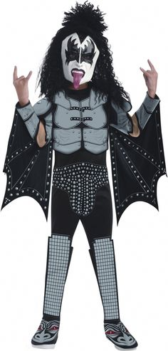 Deluxe Kiss Demon Gene Simmons Halloween Costume - This is a licensed Demon Child costume from the rock band Kiss. The costume is a one piece jumpsuit that ties behind the neck. The attached boot tops are foam with an elastic to hook under the shoe. The patterns on the front are as depicted and silk screened onto the costume. The caps on the shoulders are foam as well as the chest. #kiss #rockstar #music #yyc #calgary #costume #kids