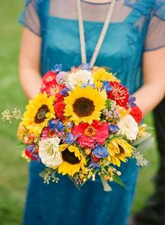 sunflower wedding colors | sunflower wedding bouquet with blue bridesmaid dress. Complimentary ...