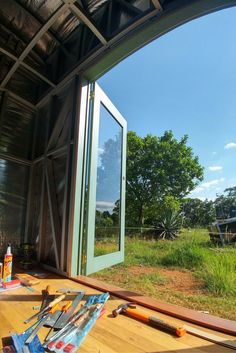 We have been busy building the french doors for our tiny house. In this post, I will explain how to build your own set of french doors. Mobile House, Our Environment, Diy Door, Tiny Living, French Doors, Tiny House, House Ideas, Container, Windows