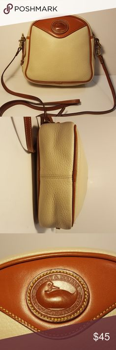 """Vintage Dooney & Bourke Crossbody Messenger Bag A cute, CREAM colored,  small vintage Dooney and Bourke Crossbody  / Messenger Shoulder Bag in GREAT pre-owned condition.  Has an open slot pocket on backside.  Unique dome shaped top. Shoulder strap is adjustable and removable and ranges from 22"""" to 28"""" in length.   Comes from my smoke free home! Dooney & Bourke Bags Crossbody Bags"""