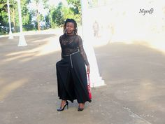 All black wide leg pants styled with a see-through top