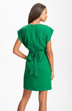 Dress tip: A bow adds a feminine touch to a simple green dress.