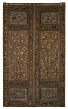 AN IMPRESSIVE PAIR OF IVORY-INLAID WOODEN DOORS, PERSIA, CIRCA 18TH CENTURY, WITH LATER INSCRIPTIONS CARVED IN THE BORDER