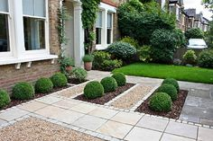 Super smart and easy to maintain arrangement for large front garden of Period property.