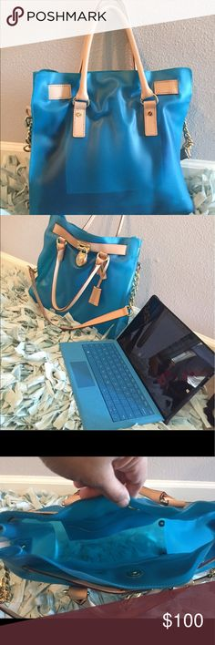 Micheal kors Hamilton gel bag Authentic MK jelly purse. It's in an excellent used condition. It comes with a key 🔑. The golden hardwares has no obvious signs of wears or scratches. If you need additional info or pics let me know. It's my first mk purse I purchased so it's well taken care of. You can put a surface tablet /mini laptop 💻 inside. Michael Kors Bags Satchels