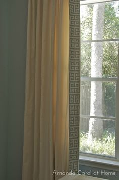 Use iron on hem tape to add a custom fabric edge to plain curtains.    Amanda Carol at Home: DIY Greek Key Trimmed Drapery