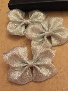 Silver glitter ribbon hair bows in the making at dreambowsUK #makinghairbows #glitterbows #crafting #handcrafted #bows