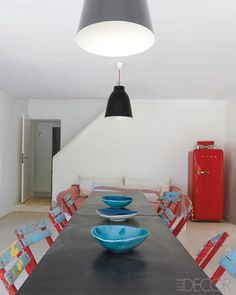 367b0ecc15 Kitchen table with rustic cafe chairs in the home of Ines de la Fressange.