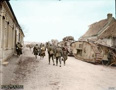 THE GERMAN SPRING OFFENSIVE, MARCH-JULY 1918 Mark V tanks of the 2nd Tank Battalion halted in Aveluy, Somme, France. 25 March 1918. Numerous isolated soldiers are passing up and down the road. (Source © IWM Q 8638) McLellan, David (Second Lieutenant) (Photographer)