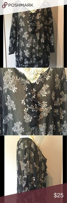 Torrid blouse Torrid sheer floral blouse, 3/4 sleeves with buttons to fold up. Ruffles and three buttons on the front, with elastic on the bottom of the blouse. In great condition, no snags, stains or holes. Torrid Tops Blouses