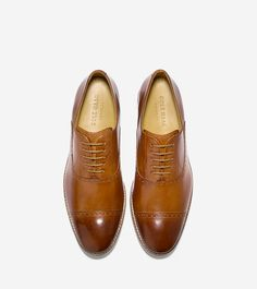 If you prefer an oxford that isn't a wingtip, these lace ups are great for denim or navy suiting.  http://www.colehaan.com/cambridge-cap-oxford-british-tan/C13416.html?dwvar_C13416_color=British%20Tan&dwvar_C13416_width=M#cgid=mens_shoes_extended_widths&start=40
