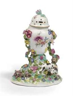 A Meissen potpourri vase and cover  Circa 1750, with blue crossed-swords mark  Of baluster form with pierced domed cover, painted with sprays of flowers, encrusted with branches of flowers issuing from a branch on a rockwork mound applied with sporting hound and game birds
