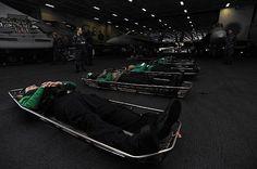 Hospital Corpsman 2nd Class Lauren Coons looks over Sailors chosen to simulate casualties for a mass casualty drill aboard the aircraft carrier USS Dwight D. Eisenhower (CVN 69).