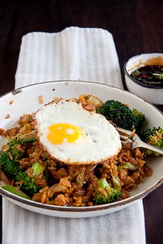 spicy rice and vegetables flavoured with soy and fish sauce topped with a fried egg, its yolk oozy and sunshine yellow. Serve this with Ketchup Manis (a sweet and thick soy sauce) and extra freshly chopped chillies.