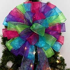 Hot Pink Turquoise Lime and Purple Glitter Sparkle Christmas Tree Topper by PackagePerfectBows on Etsy https://www.etsy.com/listing/168965926/hot-pink-turquoise-lime-and-purple