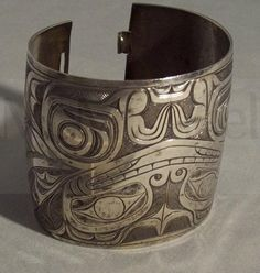 Artist: Charles Edenshaw Nationality: Canadian, First Nation, Haida Artist Dates: 1839 - 1920 Gender: male Culture: First Nation; Haida Title: Bracelet Object Dates: c. 1910 Media: silver Dimensions: 6.4 x 6.7 cm (height x outside diameter) McMichael Collection