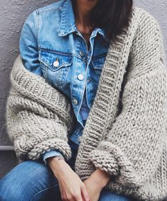 denim jacket + cabled sweater.