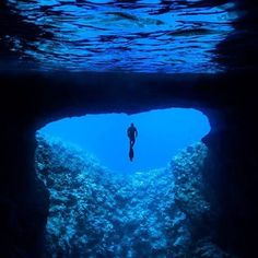 Freediver at the entrance to Mariner's Cave! This is another gem of Vava'u... a hidden underwater cave only accessible via a swim into the darkness, coming up through the surface of the mirror-like cave chamber.