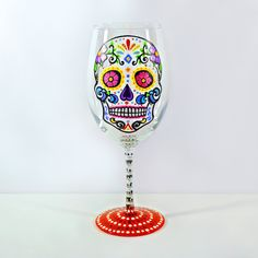 Sugar Skull Wine Glass, Hand Painted Glass. A colorful Sugar Skull is hand painted on this festive wine glass. The design is such that the liquid in the glass will color the skull making for a fun variation in the piece depending on your beverage of choice. The stem is meticulously dotted using black and white. The bottom is painted red. The perfect gift for any sugar skull collector. ❤️ Wine Glass holds 17.5 oz ❤️ This listing is for 1 Wine Glass ❤️ Collect all 4 designs (as seen in image…