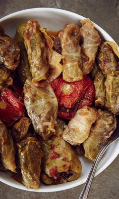 In Armenian and nearby Middle Eastern cuisines, dolma refers to a family of stuffed vegetable dishes, most often wrapped in grape or cabbage leaves. You can use this same meat-and-rice filling—and a similar steaming technique—to hollow out and stuff zucchini, eggplant, tomatoes, or peppers. Dolmas taste best warm, and leftovers can be resteamed one or more times as desired.