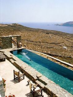 a unique, private villa for rent in mykonos, a luxurious rental property with breathatking views and amazing infinity pool in a great vacation spot.