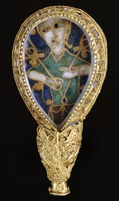 The Alfred Jewel, found in Somerset in 1693, dated to the late 9th Century rule of Alfred the Great. It is made of enamel, gold, and rock crystal. The inscription reads 'AELFRED MEC HEHT GEWYRCAN' ('Alfred ordered me to be made') It was attached to a wood pointer for reading words in a manuscript and resides at the The Ashmolean Museum in Oxford.