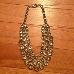 J. Crew crystal strand necklace Three strands of square, oval, rectangular, and circular crystals on a bronze link chain with lobster clasp closure! Perfect condition! Can be dressed up or worn with a casual top and jeans! J. Crew Jewelry Necklaces