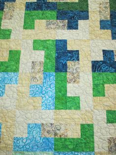 2014-2015. L & T wedding quilt close up. Where the green/cream L block and blue/cream T blocks meet to form another block.