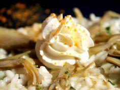 Risotto ai carciofi con mousse di burrata e polvere d'arancia