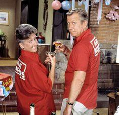 "The Brady Bunch - Alice Nelson (Ann B. Davis) and her boyfriend Sam ""The Butcher"" Franklin (Allan Melvin) pose in their league bowling shirts."
