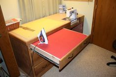 sewing desk The top drawer is a pull out ironing board with storage underneath the board.
