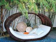 Love this Lounge Bed!  A nap on this ship-shaped daybed, inspired by a Chinese boat, may just feel like a journey across the ocean. It turns a simple backyard corner into a perfect lounging spot.