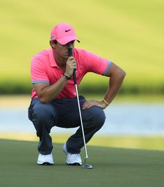 Rory McIlroy studies his putt during a round of 64 on day two of the ...