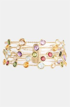 "Marco Bicego 'Mini Jaipur' 5-Strand Bracelet Hand-engraved, 18K Gold frames a colorful mix of Round Semiprecious Stones dotting a gorgeous multi-strand bracelet.  Bar closure.  Approx. length: 7"".  Actual stones may vary. Tourmaline, Quartz, Peridot, Rhodolite Garnet, Iolite, Tanzanite, Aquamarine, Apatite, Topaz, Citrine, Lemon Citrine or Amethyst.  By Marco Bicego; Made in Italy."