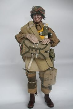 WWII US Army 101st Airborne Division paratrooper in full jump rig...