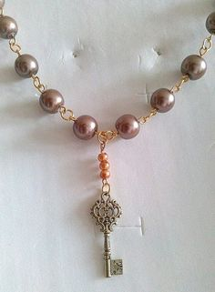Bronze and gold coloured beaded necklace with key charm by KaisCards, £7.00