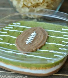 Layered dip gets an upgrade with this super cute football field preparation.