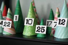 Advent calendar cones mad with scrapbook paper and it is an awesome decoration!!  put little gifts inside or things to do for the season(i.e. watch a Christmas movie, make christmas cards, have hot chocolate, make an ornament for the tree, etc.)