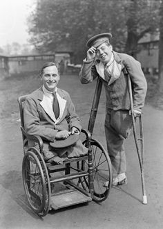 """Two UK cheery amputees of WW1 smile for the camera. Posed photos like this populated many publications in the immediate postwar years to underline the government's supposed rehabilitation efforts. One fact that remained little mentioned though was that those who survived their wounds did not receive any pension, save very limited """"special"""" cases."""