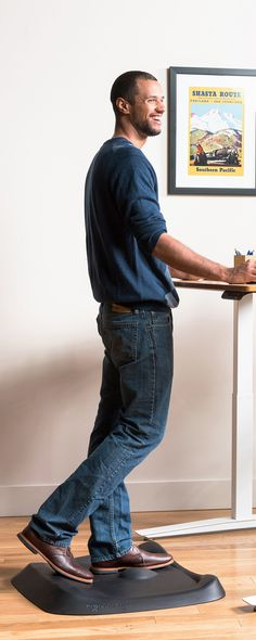 This cushiony standing desk mat has a variable surface with bumps, lips, and curves to keep feet and legs busy throughout the day. The small movements you make can help fight fatigue, stiffness, and achiness associated with standing. And because the movem