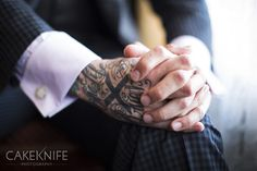 Colorado wedding photographer Marla Rutherford photographs groom in a boutique San Francisco hotel. These tattoos mark a straight edge lifestyle.