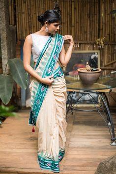 Cream Sambalpuri cotton saree with dark green temple border and silver edging saree