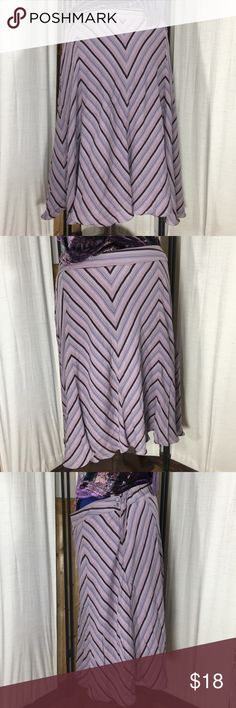 "Jones New York Pink Striped 100% Silk Skirt Sz 22 Super flirty and fun! 100% silk skirt in a dusty pink chevron print pattern.  Size 22.  Has a zipper and button closure on side.  Pre-owned but in good condition. Measurements (flat): waist: 20""; hips: 29""; bottom hem: 53""; length: 28"". Jones New York Skirts A-Line or Full"