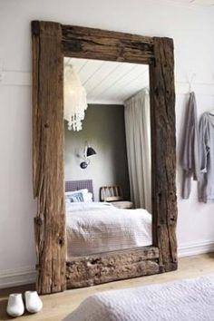 large barnwood mirror on floor by Liya Banks