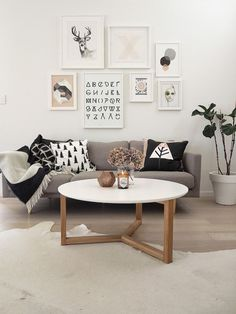 Love the clean style of this space. The table totally fits in and the frames on the wall spice it up quite nice!