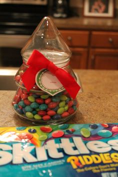 Very simple $5.00 gift for your neighbors or mailman. 1.98 glass tree, 2.48 bag of Skittles, and gas money to Walmart.